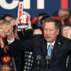 Ohio Gov. John Kasich, with his wife, Karen, at his side, cheers with supporters Tuesday at his Republican primary night rally in Concord, N.H.