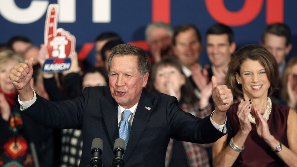 Ohio Gov. John Kasich, with his wife, Karen Waldbillig, at his side, cheers with supporters Tuesday at his Republican primary night rally in Concord, N.H. (Jim Cole/AP)