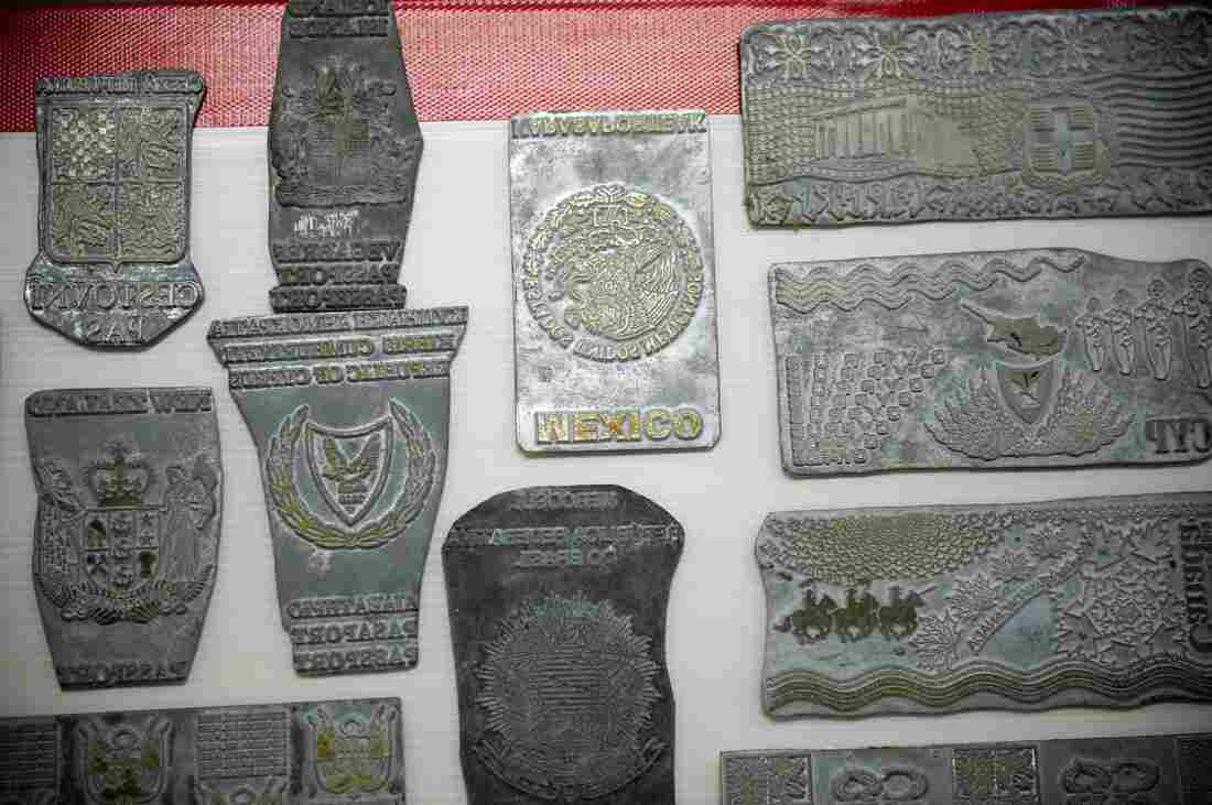 """Counterfeit passport printing plates allegedly used by """"The Doctor"""" are displayed at the immigration bureau in Bangkok."""