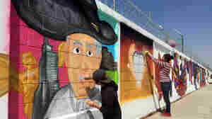 The city of Ecatepec, Mexico, whitewashed nearly 4 miles of a wall along the pope's travel route and gave 50 local graffiti artists a spot to lay-up their best Francis-inspired drawing.