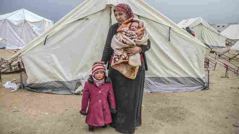 Belkiz Halip and her children Eye (left) and Zehra fled bombing in Aleppo to a tent city close to the Bab al-Salam crossing on the Turkish-Syrian border.