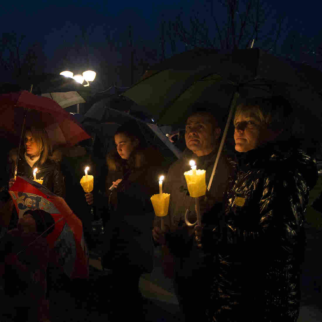 People gathered during a candlelight procession to honor the memory of Giulio Regeni in his hometown of Fiumicello, Italy, on Sunday.