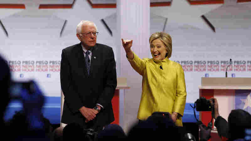 Democratic presidential candidates Sen. Bernie Sanders and Hillary Clinton take the stage before a Democratic presidential primary debate at the University of Wisconsin-Milwaukee on Thursday.