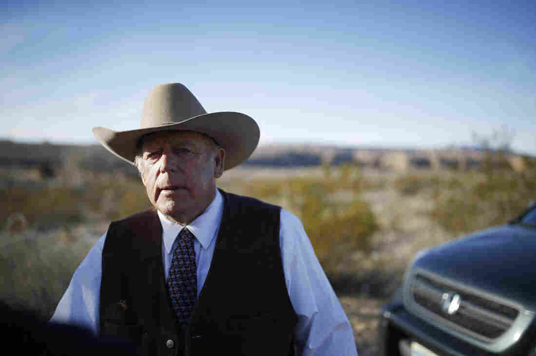 Cliven Bundy stands along the road near his ranch after speaking with media in Bunkerville, Nev., on Jan. 27. His sons led the occupation of the Malheur National Wildlife Refuge in Oregon, and he was arrested Wednesday on charges stemming from a 2014 standoff with federal agents.