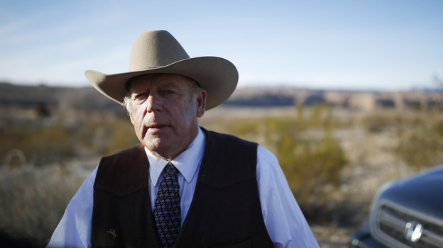 Cliven Bundy stands along the road near his ranch after speaking with media in Bunkerville, Nev., on Jan. 27. His sons led the occupation of the Malheur National Wildlife Refuge in Oregon, and he was arrested Wednesday on charges stemming from a 2014 standoff with federal agents. (AP)