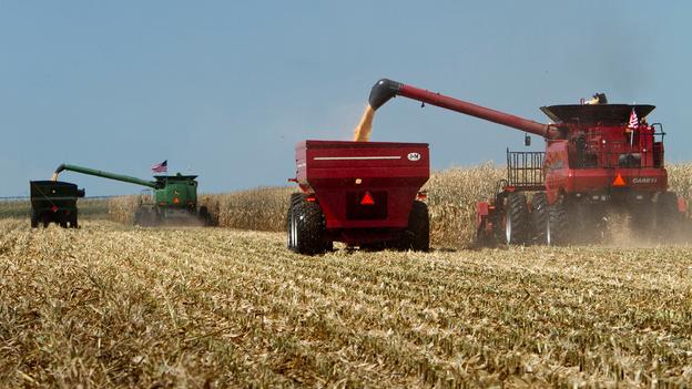 Combines harvest a corn field in Grand Island, Neb. (AP)