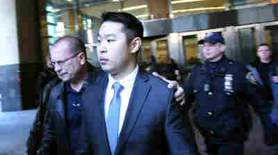 New York City police officer Peter Liang is escorted out of court after he was convicted of manslaughter on Thursday in the Brooklyn borough of New York City.