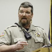 Harney County Sheriff Dave Ward addresses the public at the County Chamber of Commerce in Burns, Ore., on Thursday.