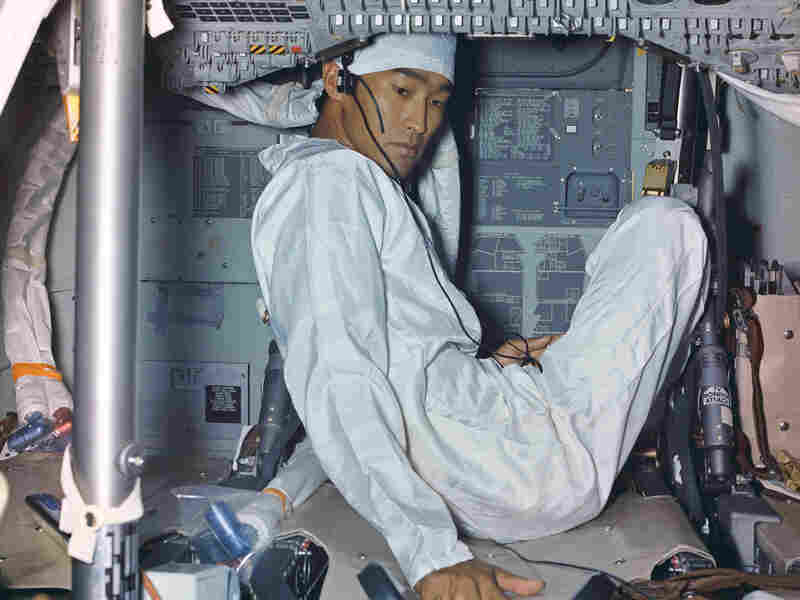 The astronauts were quarantined for several weeks following the mission at a NASA facility in Texas. Quarantined with them was a photographer and technician, John Hirasaki, who is seen here, as is the condition of the cabin shortly after it arrived back in the country. Note the calendar on the left.
