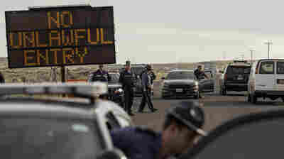 Law enforcement agencies monitor a road block near the Malheur Wildlife Refuge Headquarters near Burns, Ore., on Thursday.
