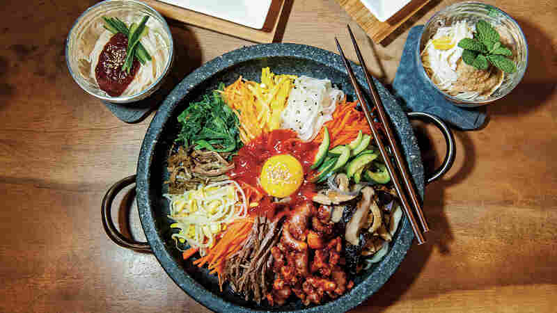 """Bibimbap is one of the best-known Korean dishes. According to chef Deuki Hong and writer Matt Rodbard, there really isn't a definitive recipe. """"The name translates to 'mixed rice,' and, in practice, rice is the dish's only constant,"""" the authors write in their new cookbook, Koreatown."""