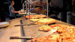 Heat lamps warm fresh pizza in the food line at the Cleveland Metroparks Zoo's Amazon Cafe in the Rainforest. The dining area has increased offerings of healthful foods such as salads, but pizza, fries and corn dogs remain popular choices among visitors.