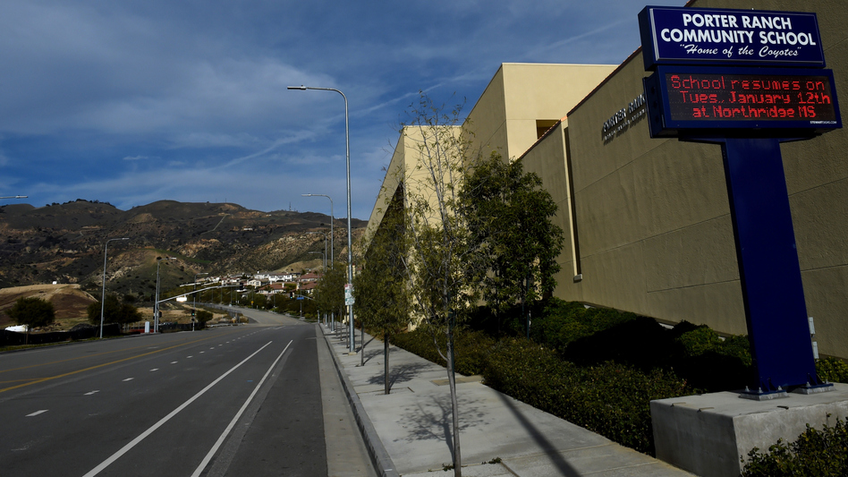 Deserted streets and a sign advising students to attend another school are seen in this photo of the Porter Ranch Community School, taken in January. (Mark Ralston/AFP/Getty Images)