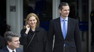 Spain's Princess Cristina (left) and her husband, former Olympic handball player Inaki Urdangarin (right) leave the courtroom in Mallorca on Feb. 9. Cristina, the Spanish king's sister, is accused of doing fraudulent business deals on the island. Urdangarin faces charges of embezzlement and money-laundering.