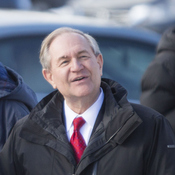 Republican presidential candidate Jim Gilmore greets voters Tuesday outside the polling place at Webster School in Manchester, N.H. He got 134 votes in the Granite State, fewer than three bigger-name candidates who already had dropped out of the race.