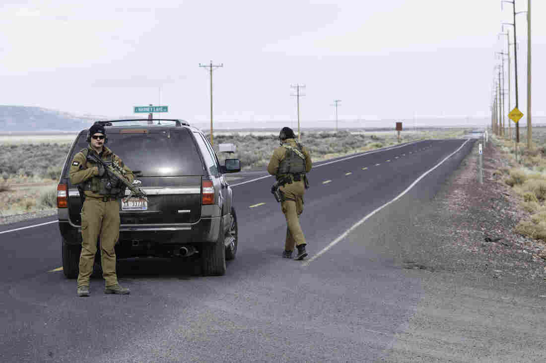FBI agents close a stretch of road near the Malheur Wildlife Refuge Headquarters on Thursday. The FBI surrounded the last protesters holed up there amid reports they will surrender.