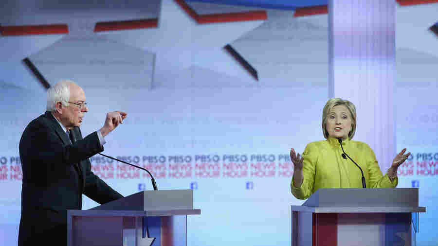 Bernie Sanders and Hillary Clinton participate in the PBS NewsHour Democratic presidential candidate debate at the University of Wisconsin-Milwaukee on Thursday.