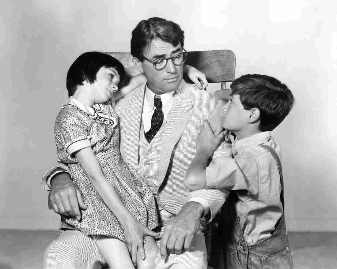 "It was recently announced that Aaron Sorkin will be adapting To Kill A Mockingbird for Broadway. Above, Scout's legs are tired after a particularly long ""walk and talk."" (Not really.) Above, Gregory Peck as Atticus Finch with Mary Badham as Scout and Phillip Alford as Jem in the 1962 film adaptation of Harper Lee's novel."