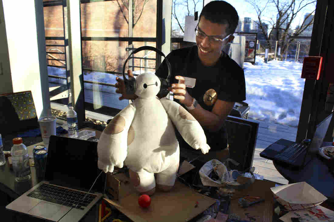 """Ammar Al-Kahfah plays with a stuffed """"Baymax"""" toy at the Georgetown Hackathon in Washington, D.C. His team has wired it to move and to collect basic medical information."""