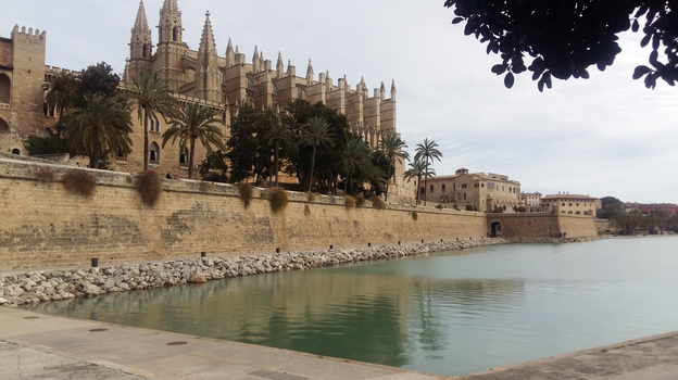 The Almudaina Palace (left) is one of two royal palaces on Spain's Mallorca island. (Lauren Frayer for NPR)