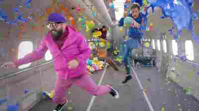 """The members of OK Go float in zero gravity in a scene from their latest video, for the song """"Upside Down & Inside Out."""""""