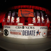 Construction crews work on the stage before the CBS News Republican presidential debate at the Peace Center in Greenville, S.C.