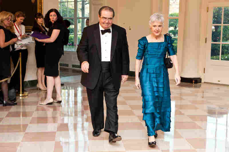 Supreme Court Justice Antonin Scalia and Maureen M. Scalia arrive for a State Dinner in honor of British Prime Minister David Cameron at the White House in March 2012 in Washington, D.C.