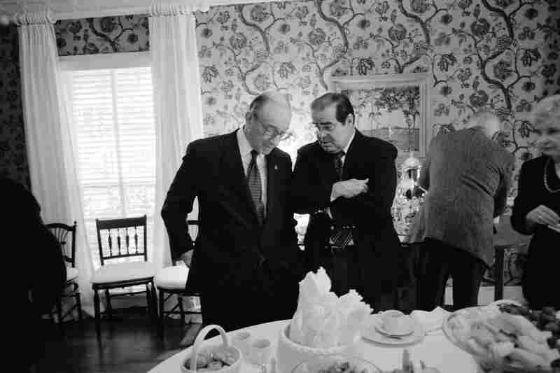 Chairman of the Federal Reserve Board Alan Greenspan (left) and Justice Antonin Scalia talk during a gathering for John E. Robson, President and Chairman of the Export-Import Bank of the United States, at Secretary of Defense Donald Rumsfeld's home in 2001.