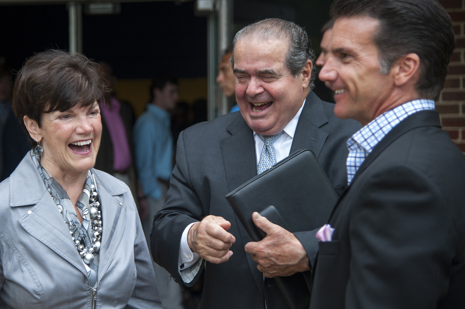 Supreme Court Justice Antonin Scalia laughs after a graduation ceremony at Stone Ridge School of the Sacred Heart in Bethesda, Md., where Scalia gave the commencement address in June 2015. (The Washington Post/Getty Images)