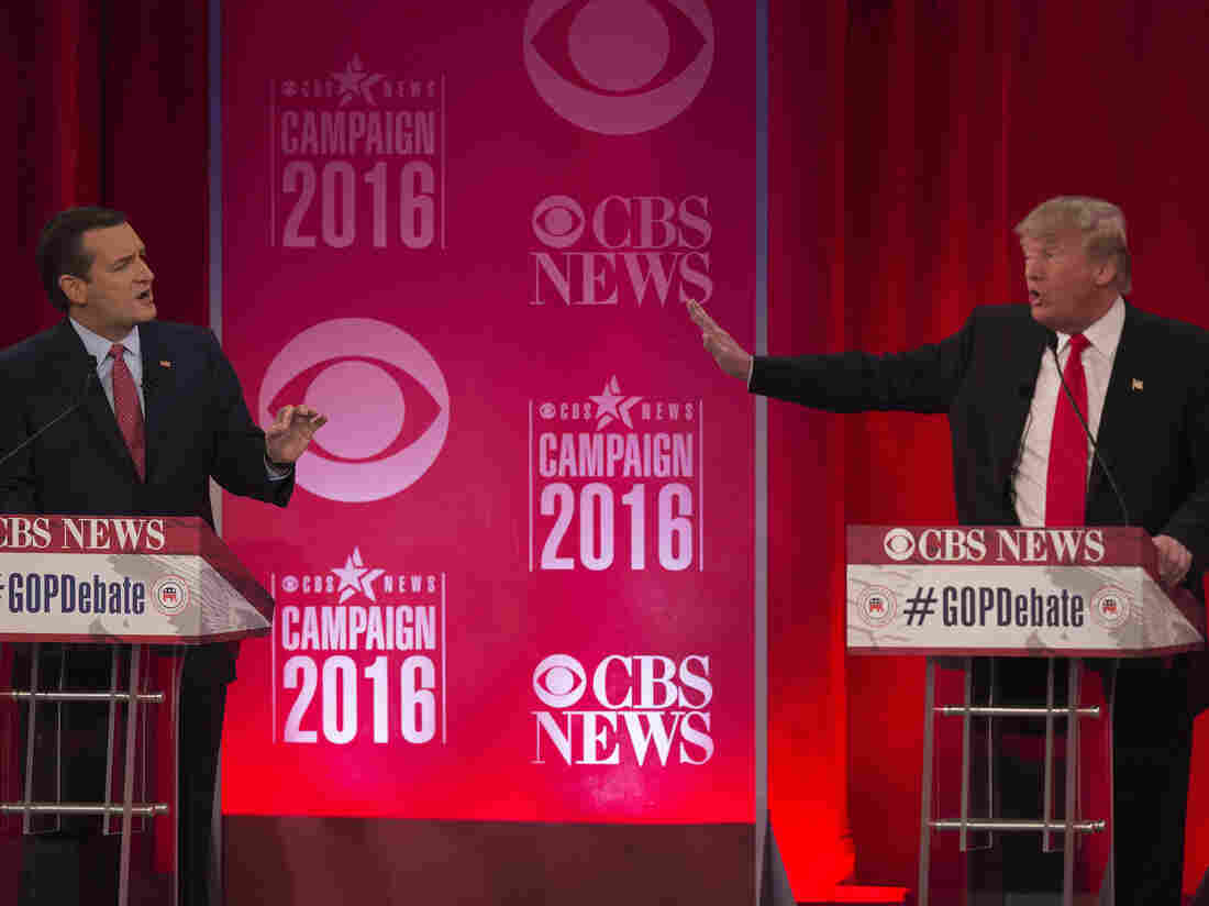 Republican presidential candidates Donald Trump and Ted Cruz  argue during the CBS News Republican Presidential Debate in Greenville, South Carolina on Saturday.