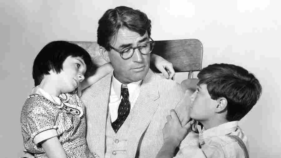 """It was recently announced that Aaron Sorkin will be adapting To Kill A Mockingbird for Broadway. Above, Scout's legs are tired after a particularly long """"walk and talk."""" (Not really.) Above, Gregory Peck as Atticus Finch with Mary Badham as Scout and Phillip Alford as Jem in the 1962 film adaptation of Harper Lee's novel."""