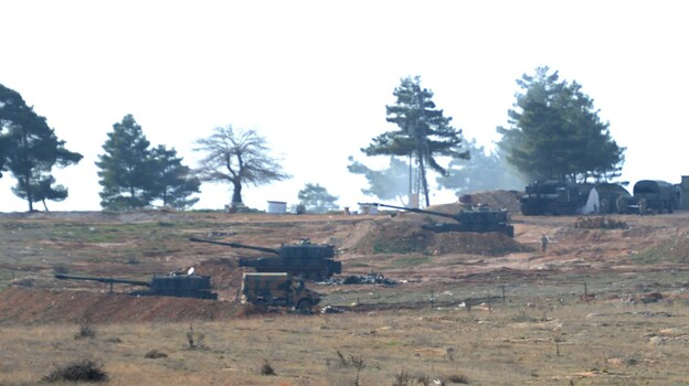From Turkish side of the Syrian border, Turkish army howitzers shell Kurdish targets in Syria on Sunday. (Getty Images)