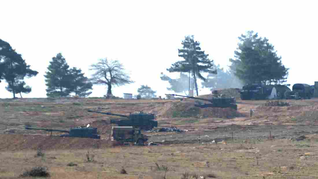 From Turkish side of the Syrian border, Turkish army howitzers shell Kurdish targets in Syria on Sunday.