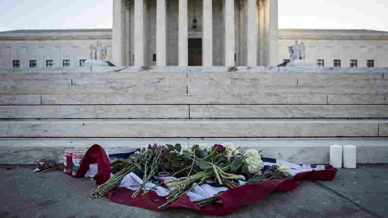 Flowers and candles sit at the foot of the U.S. Supreme Court following the death of Supreme Court Justice Antonin Scalia.