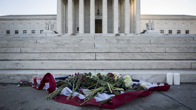 Flowers and candles sit at the foot of the U.S. Supreme Court following the death of Supreme Court Justice Antonin Scalia. (Getty Images)