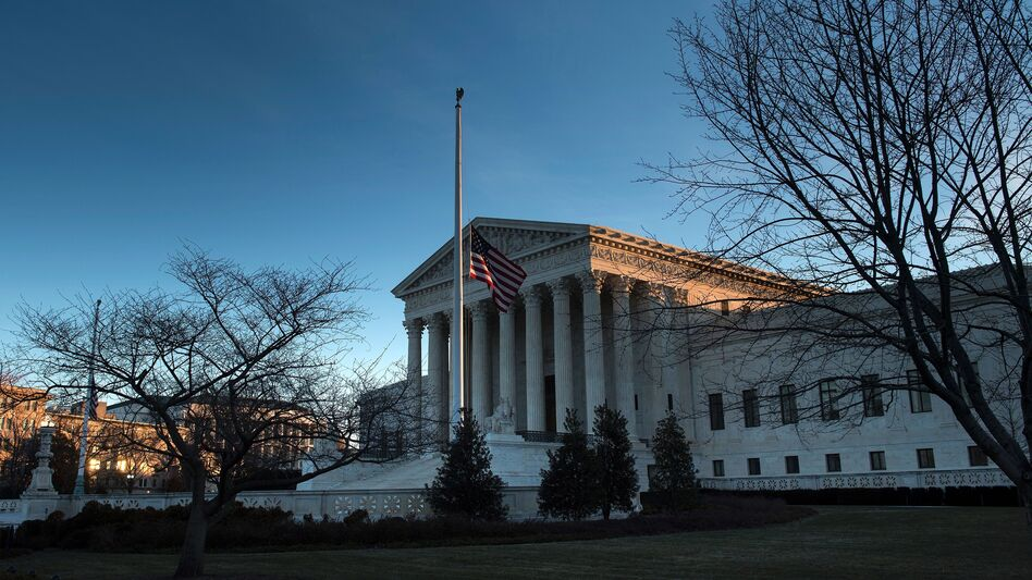 An American flag flies at half-staff outside the U.S. Supreme Court after the death of Justice Antonin Scalia. The fight to replace him could be historic, resulting in the longest vacancy in history. (Brendan Smialowski/AFP/Getty Images)
