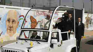 Pope Francis waves from the popemobile upon arrival in Ecatepec — a rough, crime-plagued Mexico City suburb — on Sunday. Pope Francis has chosen to visit some of Mexico's most troubled regions during his five-day trip to the country.