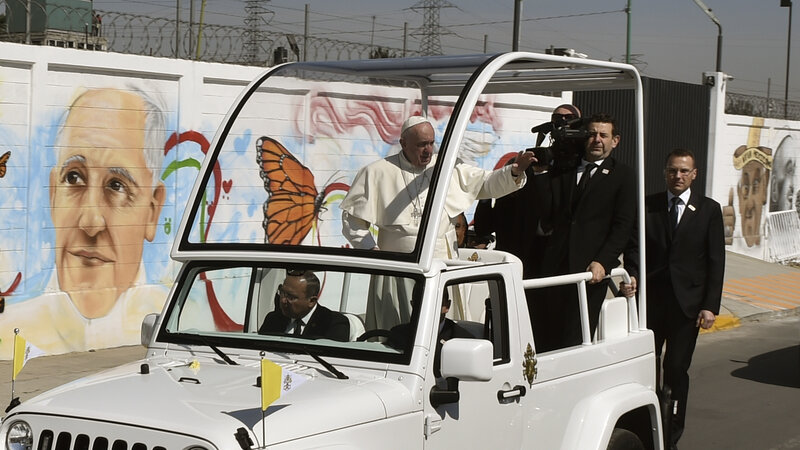 Pope Francis waves from the popemobile upon arrival in Ecatepec — a rough, crime-plagued Mexico City suburb — on Sunday. Pope Francis has chosen to visit some of Mexico's most troubled regions during his five-day trip to the country. (Yuri Cortez/AFP/Getty Images)