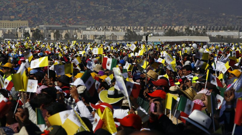 An estimated 300,000 people attended the open-air Mass in Ecatepec on Sunday. (Hector Guerrero/AFP/Getty Images)