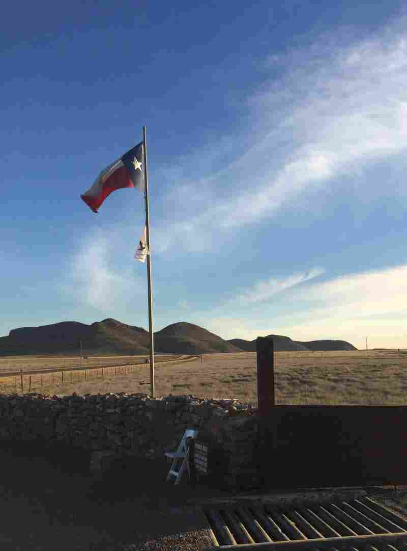 The Texas flag flies above the gate at Cibolo Creek Ranch on Feb. 13.