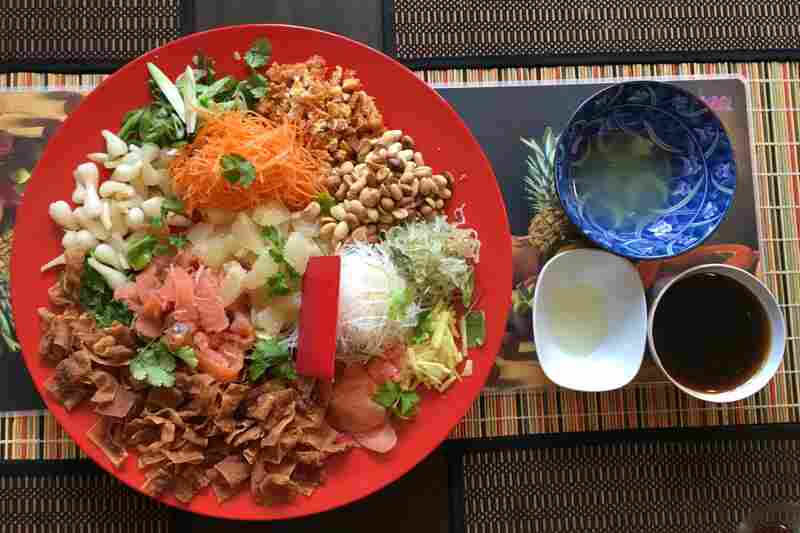 """Yusheng, a traditional Southeast Asian dish meaning """"Prosperous Toss,"""" as prepared by Alex Wong at his home in Maryland."""
