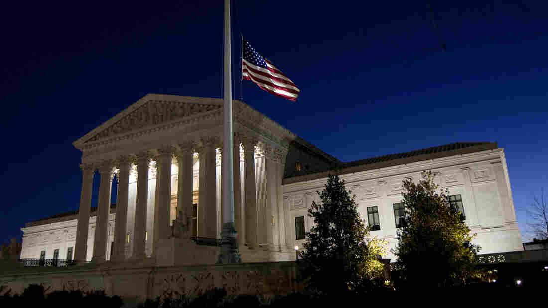 An American flag flies at half-staff in front of the U.S. Supreme Court building in Washington to honor the late Supreme Court Justice Antonin Scalia.