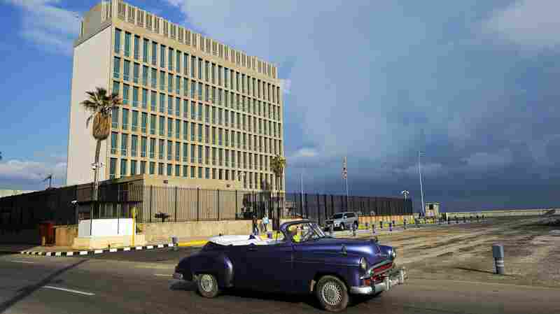 For the first time since Gallup started asking the question, 54 percent of Americans said they see Cuba favorably. Here, an old American car passes by the U.S. Embassy in Havana on Dec. 17, when the United States announced a plan to resume regular flights to and from Cuba.