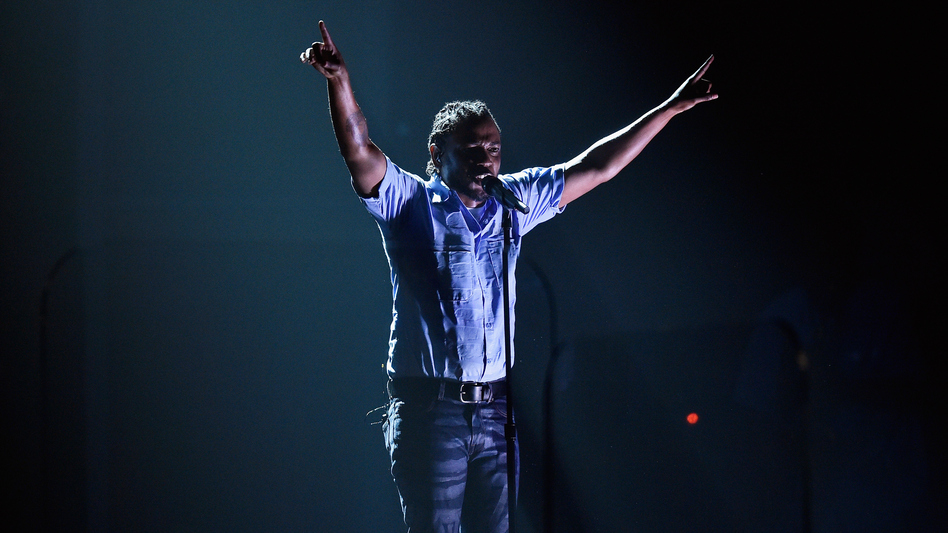 Rapper Kendrick Lamar performs onstage during the 58th Grammy Awards.