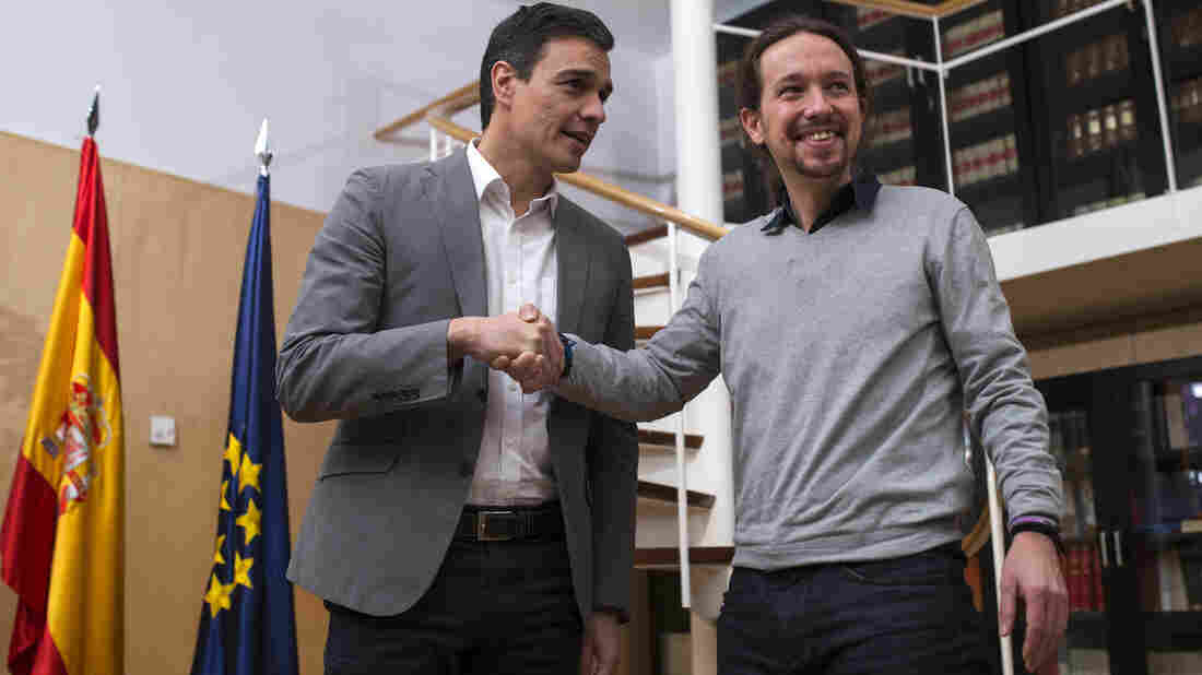 Podemos Party leader Pablo Iglesias (right) seen here with Spain's Socialist Party leader Pedro Sanchez, has asked for a referendum on Catalan independence as their two parties negotiate forming a new government.