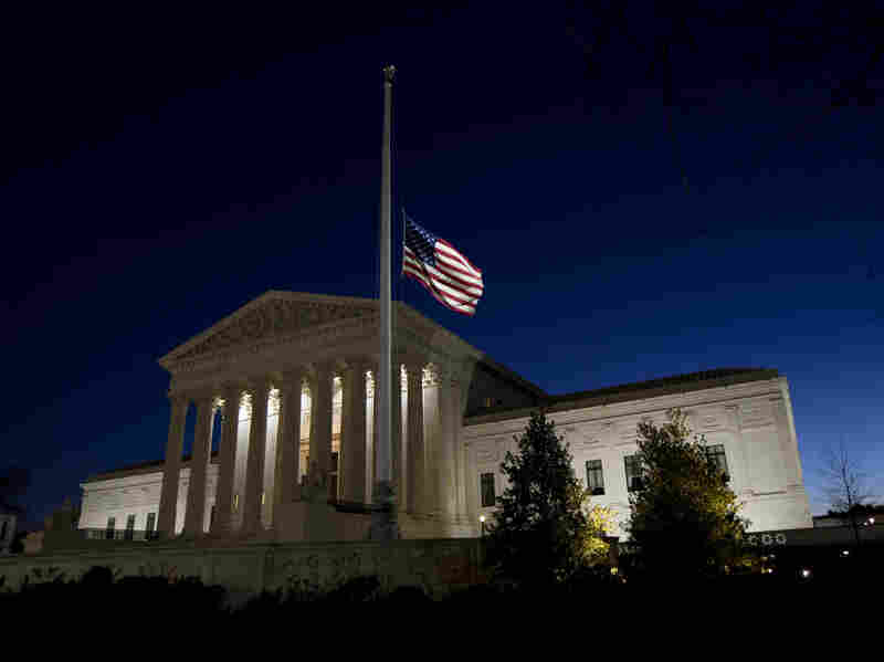 An American flag flies at half-staff in front of the U.S. Supreme Court building in honor of Supreme Court Justice Antonin Scalia.