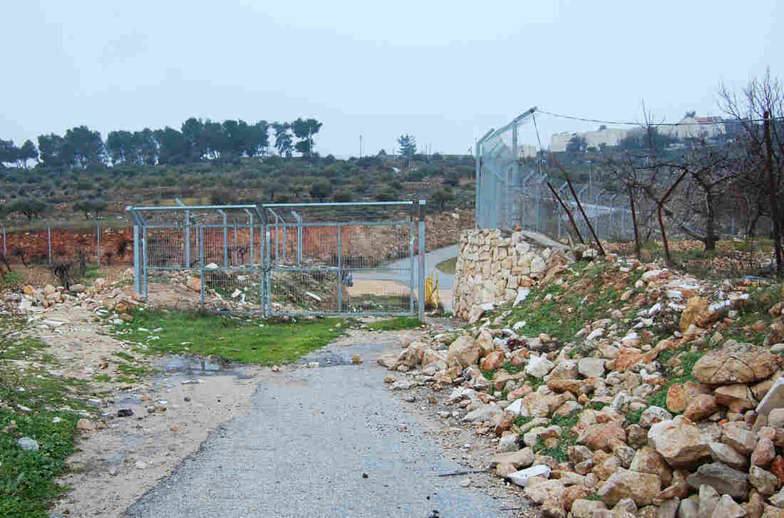 Israelis put up a small fence at the edge of the Palestinian village of Wadi Nis more than a decade ago to stop Palestinians from driving into the settlement of Efrat.