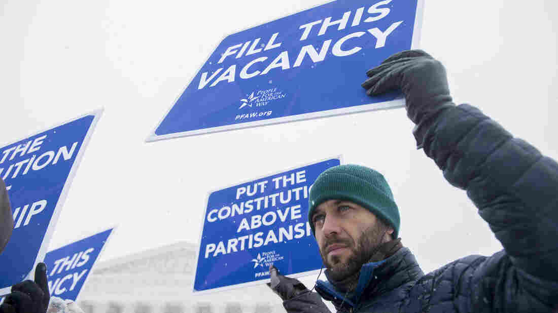 Activists with People For the American Way demonstrate outside the Supreme Court Monday, calling on Congress to give consideration to whomever President Obama nominates to replace Antonin Scalia.