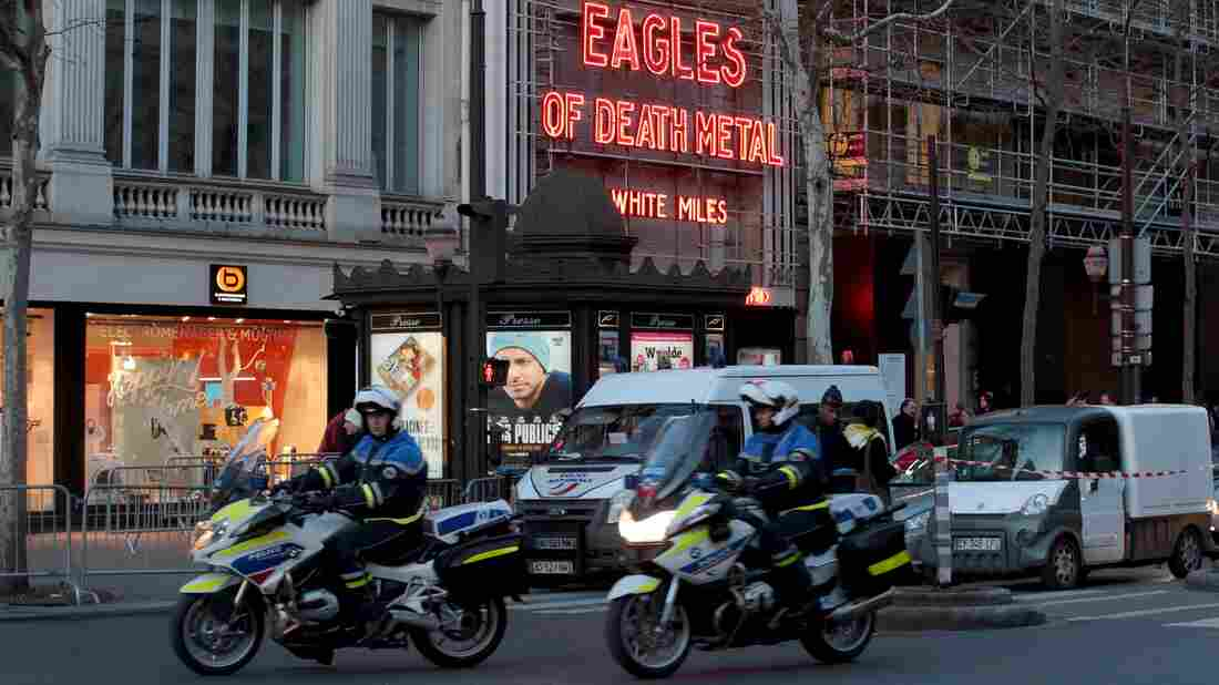 Police drive past the Olympia concert venue in Paris a few hours before a makeup concert by U.S. rock group Eagles of Death Metal on Tuesday.