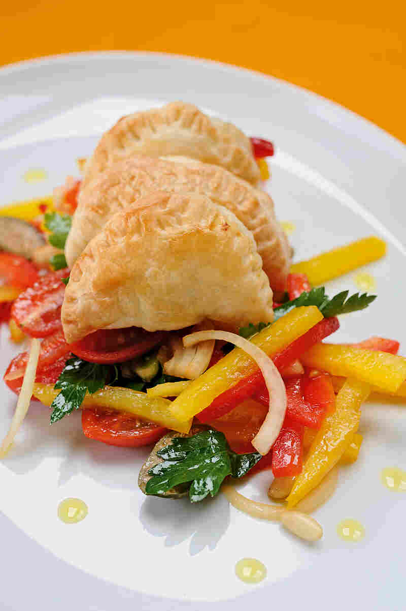 Empanadas are among Pope Francis' comfort foods. Above, Argentine Empanadas on Pepper Salad, from The Vatican Cookbook.